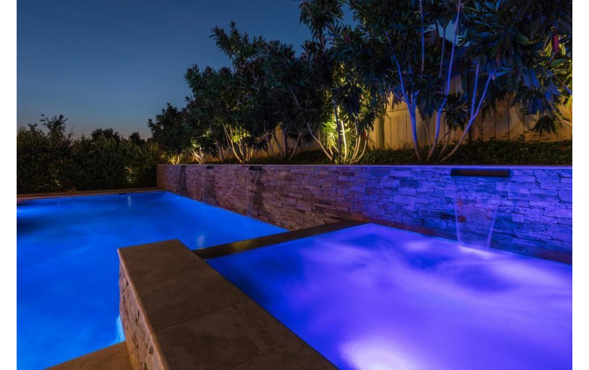 13. LEDs Cast Alluring Purple Glowing on Pool
