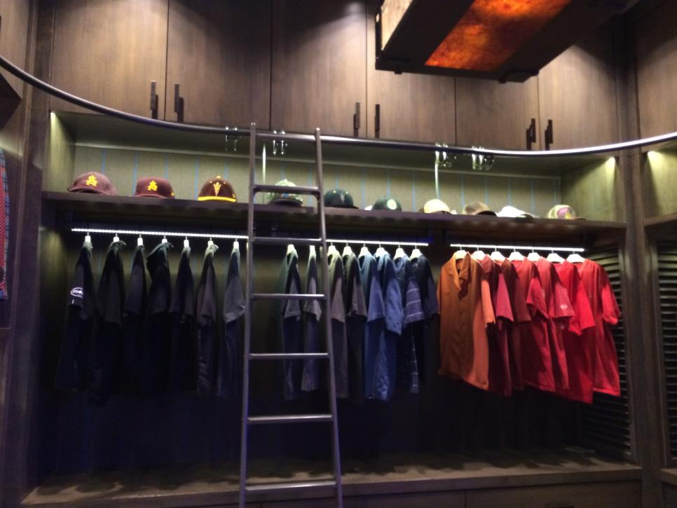 ... In This Masculine Closet. Small Lightings Illuminate A Shelf That Holds  A Collection Of Baseball Caps While A Metal Ladder On A Sliding Rail Allows  Easy ...
